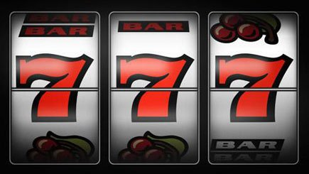 photo of a slot machine showing 3 numeral sevens