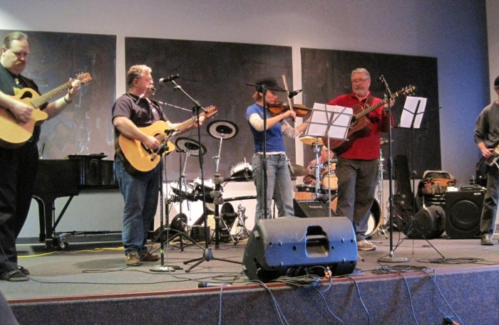 members of Dyssband on stage for a sound check