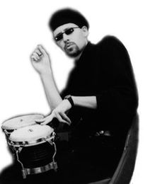 Greyscale photo of a beatnick, complete with goatee, beret, and bongos