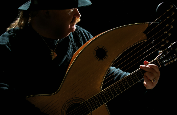 The cover of the Walking Softly EP showing Jim with his harp guitar